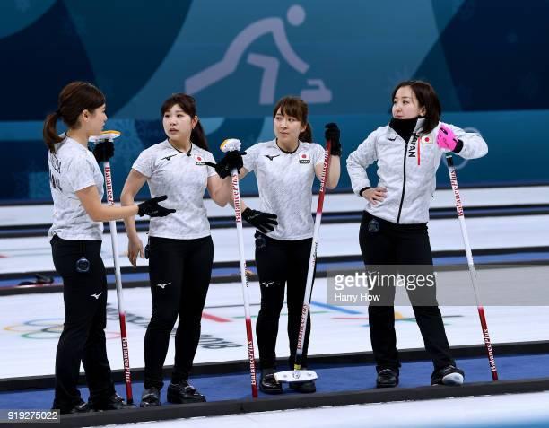 Chinami YoshidaYurika Yoshida Yumi Suzuki and Satsuki Fujisawa of Japan meet to talk in a match against the Olympic Athletes from Russia during the...