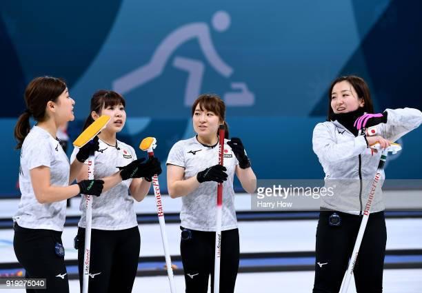 Chinami Yoshida,Yurika Yoshida, Yumi Suzuki and Satsuki Fujisawa of Japan meet to talk in a match against the Olympic Athletes from Russia during the...
