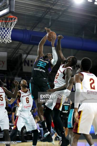 Chinanu Onuaku of the Greensboro Swarm drives to the basket against Deng Adel of the Canton Charge on January 21 2019 at Greensboro Coliseum...