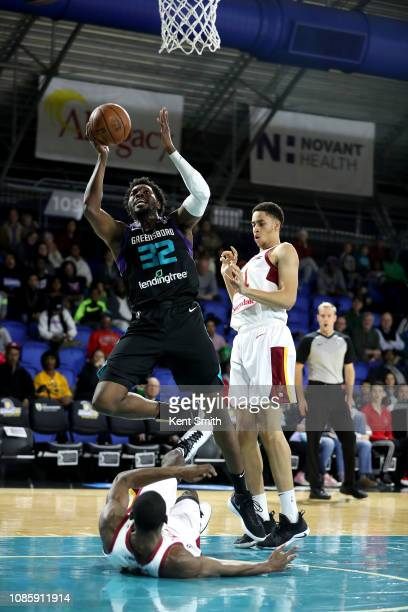 Chinanu Onuaku of the Greensboro Swarm drives to the basket against Kobi Simmons of the Canton Charge on January 21 2019 at Greensboro Coliseum...
