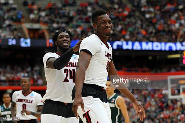 Chinanu Onuaku of the Louisville Cardinals reacts with teammate Montrezl Harrell in the first half of the game against the Michigan State Spartans...
