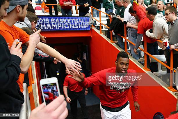 Chinanu Onuaku of the Louisville Cardinals runs to the court prior to their game against the Michigan State Spartans during the East Regional Final...