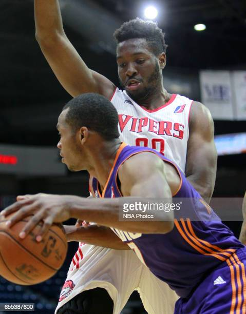 Chinanu Onuaku of the Rio Grande Valley Vipers defends against Elijah Millsap of the Northern Arizona Suns at the State Farm Arena March 19 2017 in...