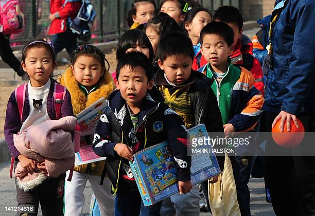 STORY 'ChinapoliticscongressNPCeducationsocietyFOCUS' by Neil Connor School children leave their elementary school at the end of classes in Beijing...