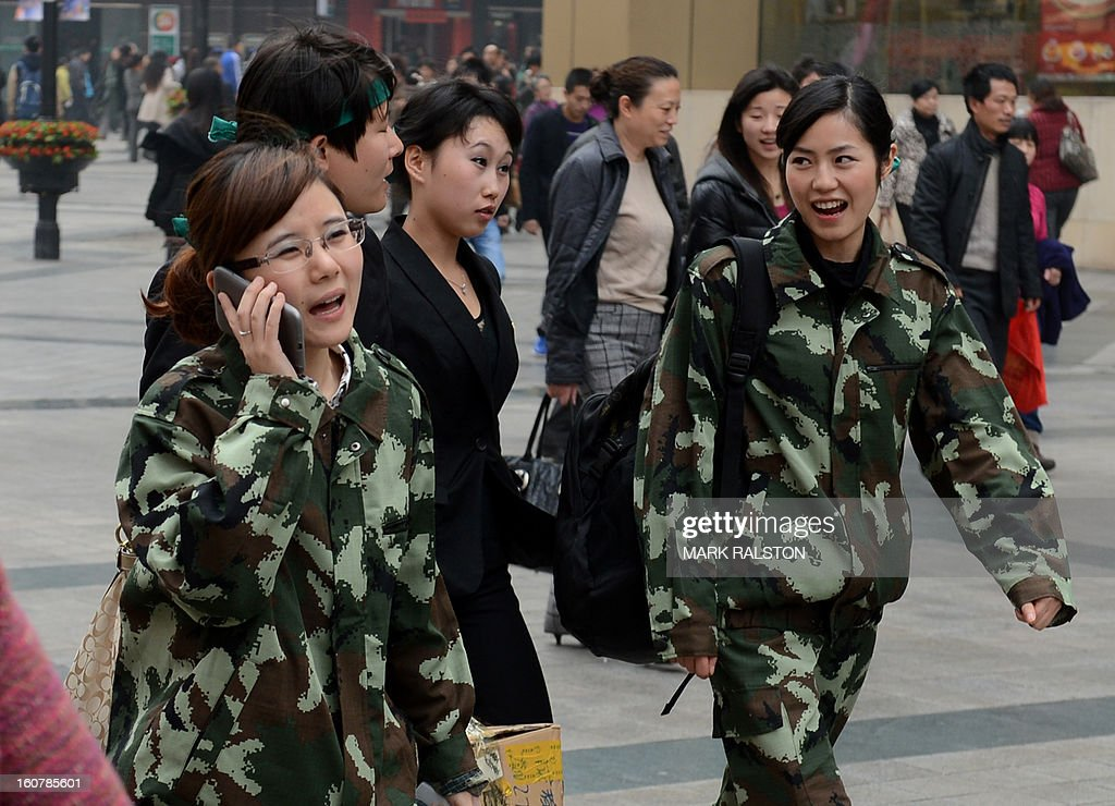 China-politics-corruption-justice-Bo,FOCUS by Neil Connor and Tom Hancock This photo taken on February 4, 2013 shows uniformed Chinese women walking through the downtown area of Chongqing after the recent announcement that the special female police squads set up by Bo Xilai would be disbanded. A year after Chongqing's police chief set off China's biggest scandal in decades, the megacity has seen revelations of torture, corruption and rights abuses, but little revolutionary change. On February 6, 2012 Wang Lijun fled to a US consulate seeking asylum after falling out with his patron Bo Xilai -- then a member of the ruling Communist Party's elite Politburo, now held at a secret location awaiting trial for crimes including abuse of power and bribery. AFP PHOTO/Mark RALSTON
