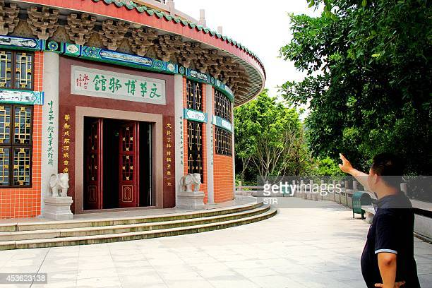 ChinapoliticshistoryFOCUS BY Felicia SONMEZ This picture taken on August 8 2014 shows a man gustures before a hall of the Cultural Revolution museum...
