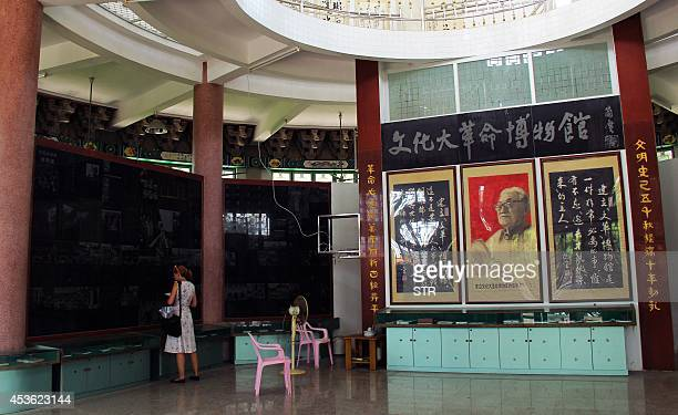 ChinapoliticshistoryFOCUS BY Felicia SONMEZ This picture taken on August 8 2014 shows a woman visiting the Cultural Revolution museum complex in...