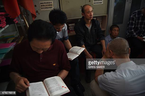 China-religion-politics-Catholic,FEATURE by Tom HANCOCK This photo taken on May 24, 2015 shows worshippers reading from the Bible as they celebrate...