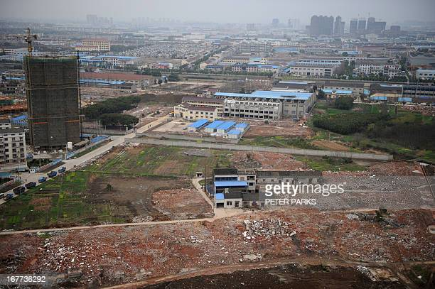 ChinarightspoliticscorruptionFEATURE by Neil Connor This picture taken on March 13 2013 shows a view of where 75yearold Yao Baohua's house still...