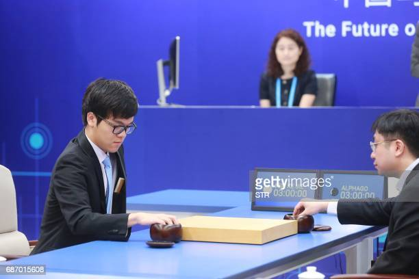 China's 19yearold Go player Ke Jie prepares to make a move during the first match against Google's artificial intelligence programme AlphaGo in...