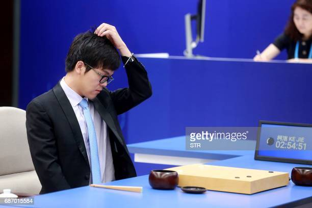 China's 19yearold Go player Ke Jie reacts during the first match against Google's artificial intelligence programme AlphaGo in Wuzhen east China's...