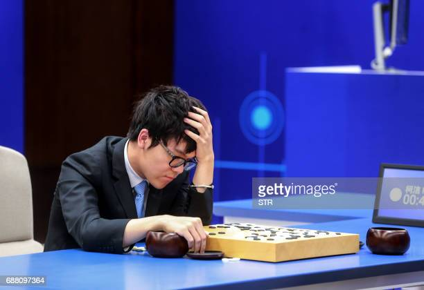 China's 19yearold Go player Ke Jie reacts during the second match against Google's artificial intelligence programme AlphaGo in Wuzhen eastern...