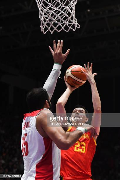 China's Abudurexiti Abudushalamu attempts a shot during the men's gold medal basketball match between Iran and China at the 2018 Asian Games in...