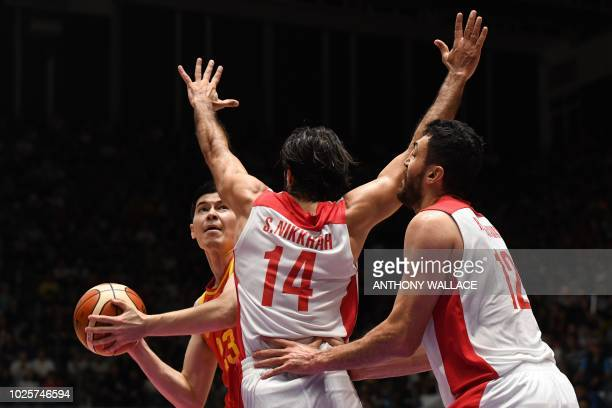 China's Abudurexiti Abudushalamu controls the ball during the men's gold medal basketball match between Iran and China at the 2018 Asian Games in...