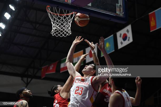 China's Abudushalamu Abudurexiti goes for the basket against Indonesia in the men's basketball quarterfinal match between China and Indonesia during...