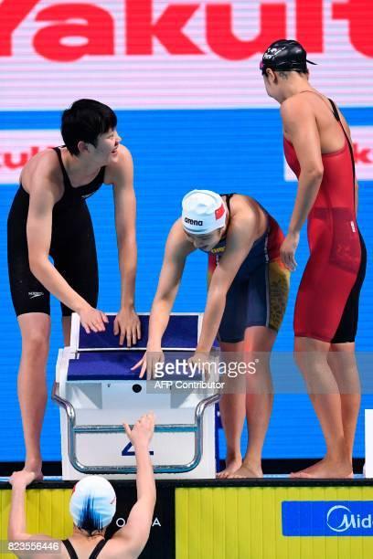 China's Ai Yanhan China's Liu Zixuan China's Zhang Yuhan and China's Li Bingjie react after the Women's 4x200m freestyle relay final during the...