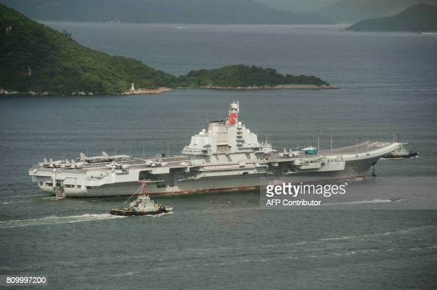 China's aircraft carrier Liaoning sails past Lamma island as it arrives in Hong Kong on July 7, 2017. China's national defence ministry had said the...