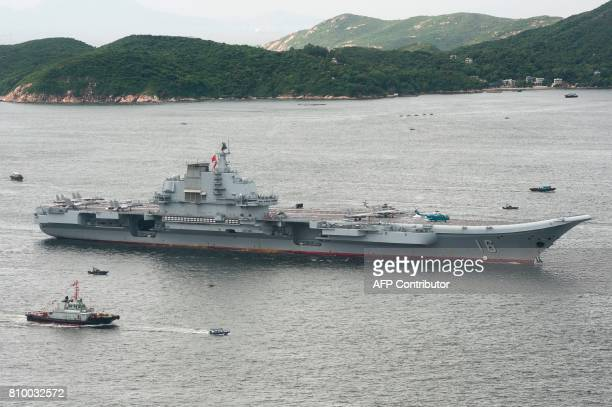 China's aircraft carrier Liaoning sails past Lamma island as it arrives in Hong Kong on July 7 2017 China's national defence ministry had said the...