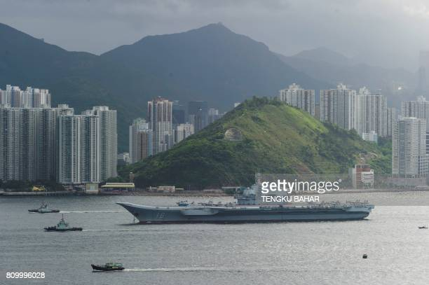 China's aircraft carrier the Liaoning sails through the Lamma Channel as it arrives in Hong Kong territorial waters on July 7 2017 China's national...