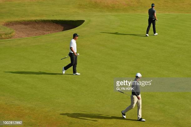 China's amateur golfer Lin Yuxin Korea's Park Sanghyun and Sweden's Alexander Bjork on the 8th green during his second round on day 2 of The 147th...