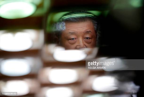 China's ambassador to Britain Liu Xiaoming is displayed on the screen of a television camera as he speaks to members of the media at the Chinese...