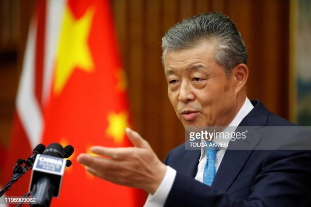 China's ambassador to Britain Liu Xiaoming takes questions from members of the media at the Chinese Embassy in London on February 6 during a press...