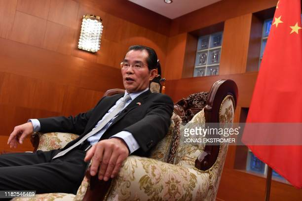 China's ambassador to Sweden Gui Congyou speaks to the media on November 15, 2019 in Stockholm, Sweden. - China on Friday threatened...