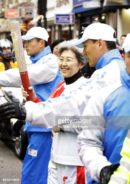 China's Ambassador to the United Kingdom Fu Ying carries the Olympic Torch during the Beijing Olympics torch relay in London