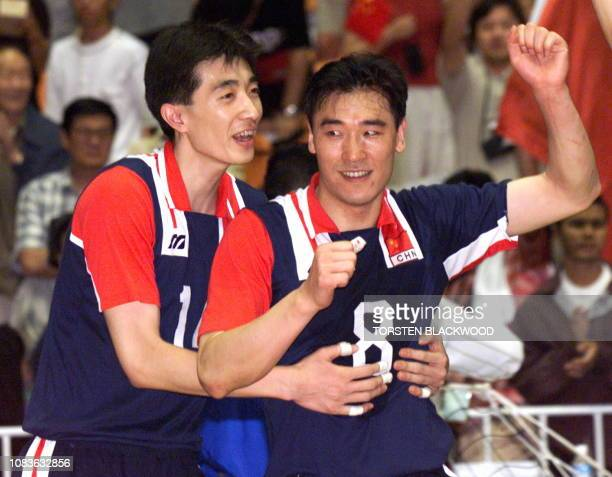 China's An JiaJie and Zhou Jianan celebrate after China defeated South Korea in the men's volleyball final at the 13th Asian Games in Bangkok 15...
