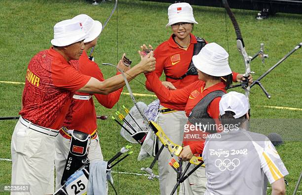 China's archery team celebrate after defeating India during the Women's Archery competition of the 2008 Beijing Olympic Games on August 10 2008 South...