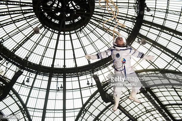 China's artist Li Wei performs at the Grand Palais on March 27 2014 in Paris as part of the Paris Art Fair AFP PHOTO MARTIN BUREAU