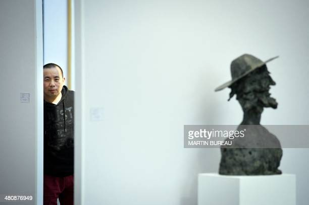 China's artist Li Wei poses at the Grand Palais on March 27 2014 in Paris on the sidelines of the Paris Art Fair AFP PHOTO MARTIN BUREAU
