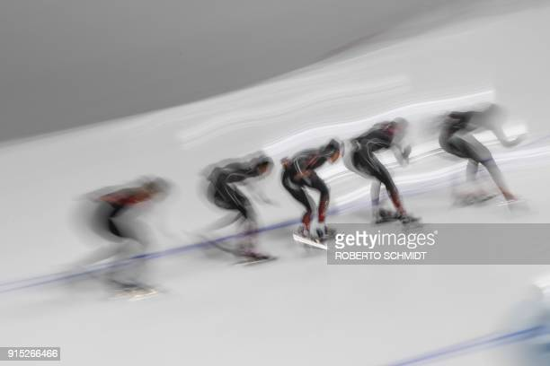 China's athletes take part in a training session of speed skating at the Gangneung Oval before the Pyeongchang 2018 Winter Olympic Games on February...