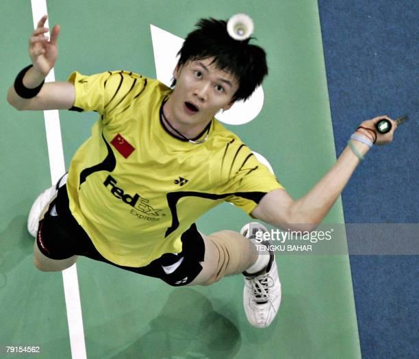 China's Bao Chunlai eyes the shuttlecock for a smash against Denmark's Kenneth Jonassen during their men's single's quarterfinals match of the...