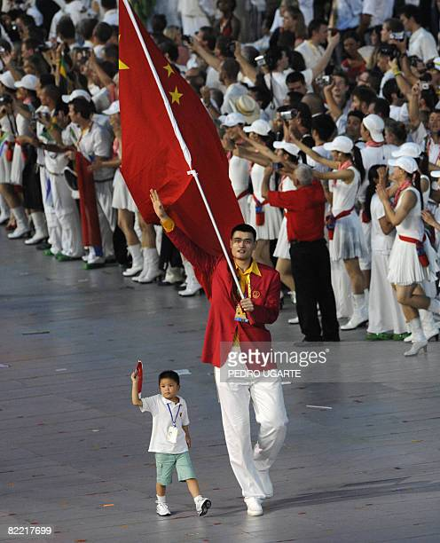 China's basketball player Yao Ming leads his country's delegation with nineyearold Lin Hao during the opening ceremony of the 2008 Beijing Olympic...