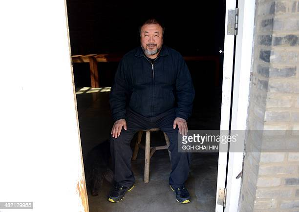 China's best known and boldest contemporary artist Ai Weiwei relaxes at his studio in the suburbs of Beijing on April 3 2014 The biggestever...
