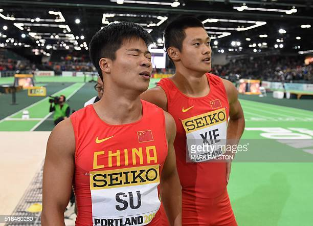 China's Bingtian Su and Zhenye Xie react after the 60 meters race at the IAAF World Indoor athletic championships in Portland Oregon on March 18 2016...