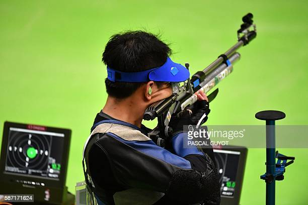 China's Cao Yifei competes during the men's 10m Air Rifle at the Olympic Shooting Centre in Rio de Janeiro on August 8 during the Rio 2016 Olympic...