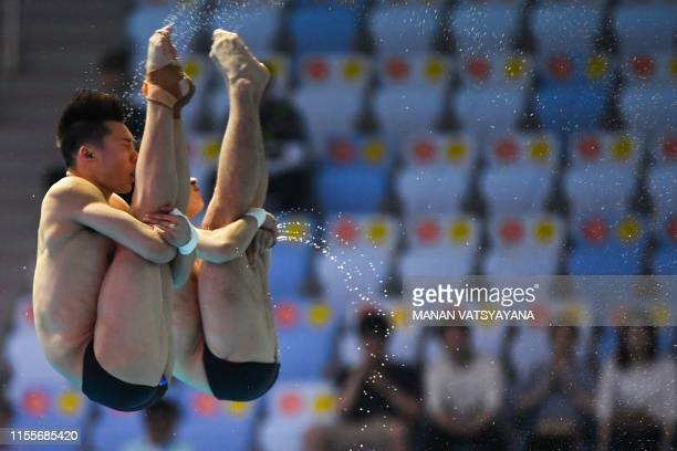TOPSHOT China's Cao Yuan China's Chen Aisen compete in the men's synchronised 10m platform diving event during the 2019 World Championships at Nambu...