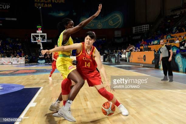 China's center Yueru Li vies with Australia's forward Eziyoda Magbegor during the FIBA 2018 Women's Basketball World Cup quarter final match between...