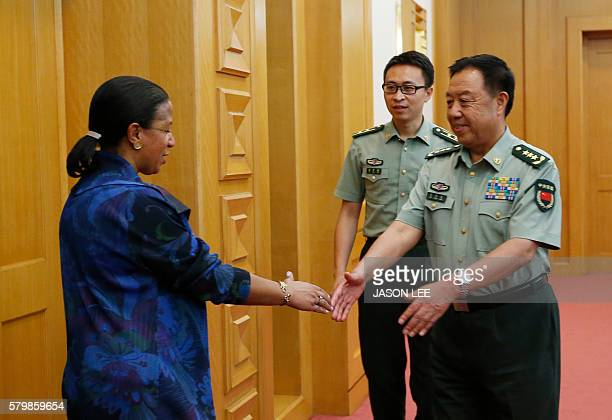 China's Central Military Commission Vice Chairman Fan Changlong shakes hands with US National Security Adviser Susan Rice at the Bayi Building in...