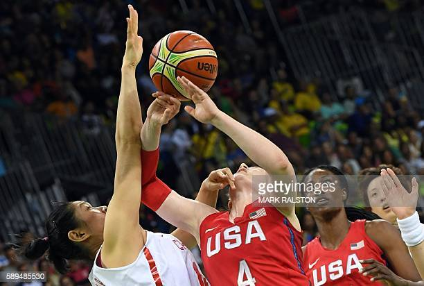 China's centre Huang Hongpin defends against USA's guard Lindsay Whalen as USA's centre Sylvia Fowles looks on during a Women's round Group B...