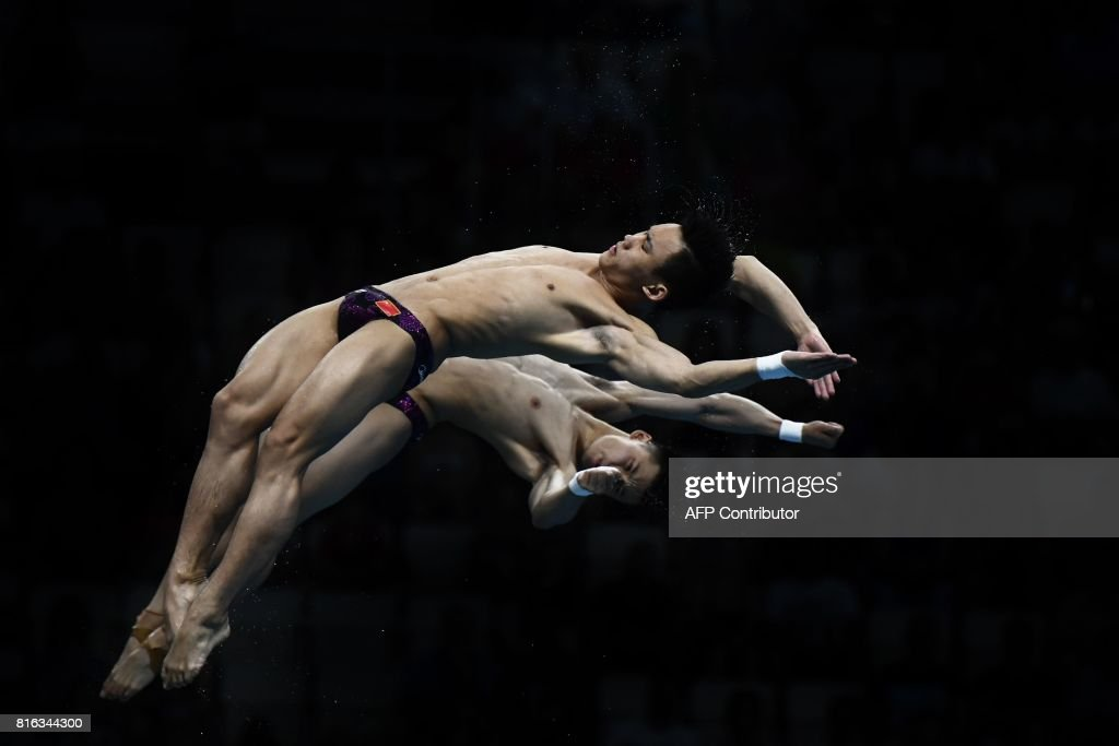 China's Chen Aisen and China's Yang Hao compete in the men's 10m platform synchro final during the diving competition at the 2017 FINA World Championships in Budapest, on July 17, 2017. /