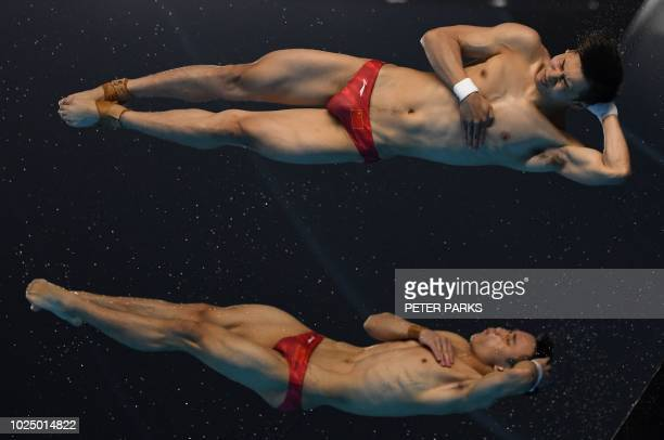 TOPSHOT China's Chen Aisen and Yang Hao perform in the men's synchronised 10m platform diving event during the 2018 Asian Games in Jakarta on August...