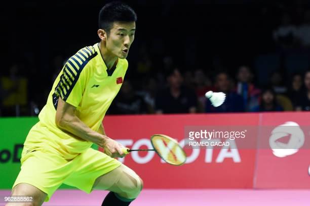 China's Chen Long hits a return against Japan's Kento Momota during their mens singles final match at the Thomas Cup badminton tournament in Bangkok...