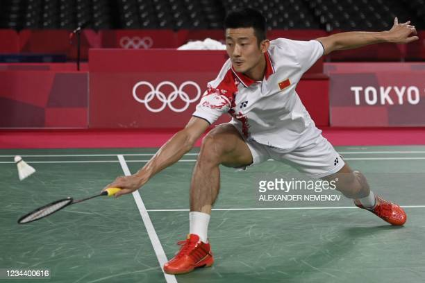 China's Chen Long hits a shot to Denmark's Viktor Axelsen in their men's singles badminton final match during the Tokyo 2020 Olympic Games at the...
