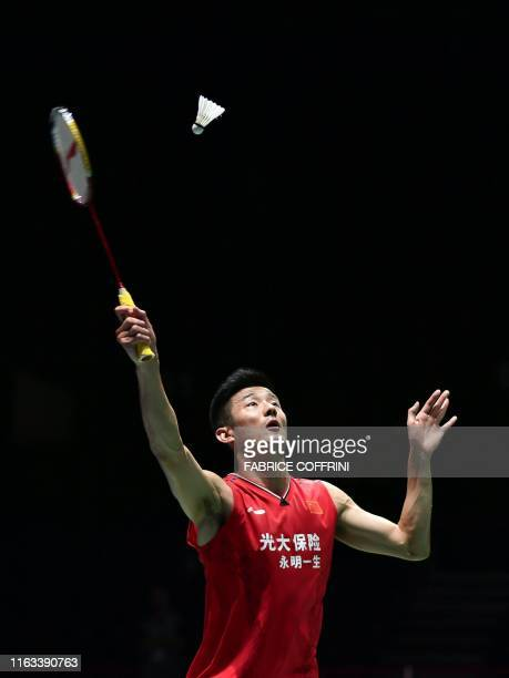 China's Chen Long returns a shuttlecock to Denmark's Anders Antonsen during their men's singles quarter final match at the BWF Badminton World...