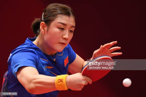 China's Chen Meng hits the ball to Hong Kong's Lee Ho Ching during their women's quarterfinal table tennis match at the Asian Games in Jakarta on...