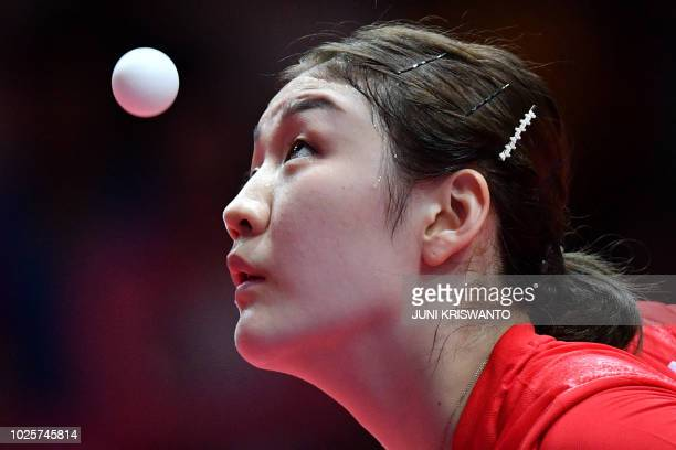 China's Chen Meng serves against China's Wang Mangyu during their women's singles table tennis gold medal match at the Asian Games in Jakarta on...