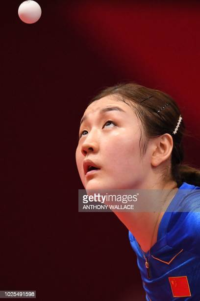 China's Chen Meng serves against Hong Kong's Lee Ho Ching during their women's quarterfinal table tennis match at the Asian Games in Jakarta on...
